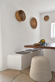 Masonry benches and table with wooden top in white dining area