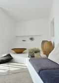 Masonry bench with seat cushions in white lounge