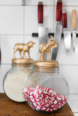 Sweet jars with animal figurines on lids