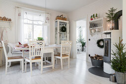 Table and chairs in festively decorated kitchen-dining room