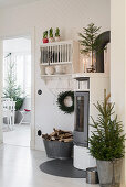 Log-burner in festively decorated kitchen-dining room