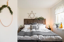 Bedroom decorated for winter in natural shades
