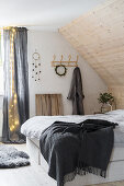 Rustic bedroom with sloping ceiling