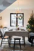 Simply decorated table in festive dining room