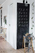 Advent calendar of numbers to strike through on chalkboard