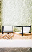 Outdoor chairs in front of wallpapered wall