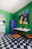 Retro-style kitchen-dining room with green walls and chequered floor