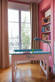Old school desk painted and decorated with name in girl's bedroom