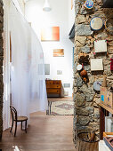 Stone wall in Mediterranean artist's apartment