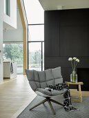 Upholstered designer armchair in modern architect-designed house