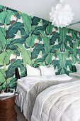 Wallpaper with pattern of topical leaves in bedroom