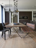 Long dining table with benches and chairs in modern kitchen-dining room