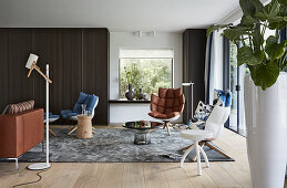 Various designer armchairs in large living room
