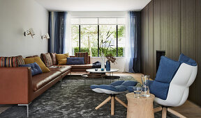 Masculine living room in earthy shades with blue accents