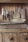 Knives and wooden boards on top of kitchen base cabinet