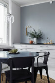 Round table and chairs in front of kitchen counter