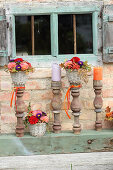 Rustic autumn arrangement of flowers and old balusters