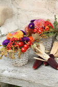 Rustic autumn arrangement of flowers and corn cobs