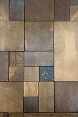 Bronze tiles of various sizes
