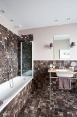 Elegant bathroom with small, dark marble tiles