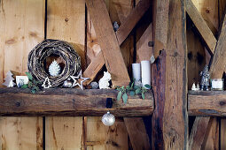 Christmas decorations on rustic wooden beams in barn