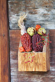 Red corn, chestnuts and rose hips