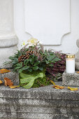 Grave decoration of hellebores and heather