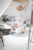 Comfortable armchair in bright attic room