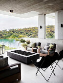 Fire pit and classic seating on terrace with concrete ceiling