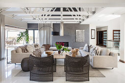Pale sofa set and black designer chairs in lounge