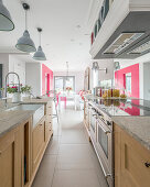 Modern country-house kitchen and dining room with hot-pink accents