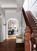 Elegant staircase with oak parquet and arch