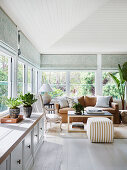 Bright winter garden with lowboard and lounge area