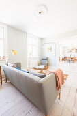 Bright, open-plan living room in retro Scandinavian style