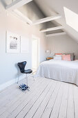 Bright attic bedroom with sloping ceiling