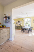 Open doorway leading from kitchen into sunny dining room