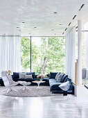 Elegant living room with upholstered furniture and glass front