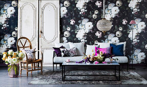Opulent floral wallpaper in the living room with dark colors