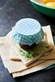 Jar of jam with blue and white gingham cover