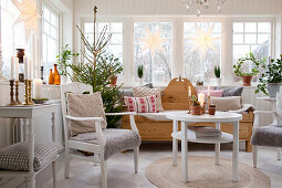 Christmas tree in Scandinavian-style conservatory