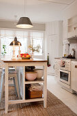 Island counter with open-fronted shelves in rustic kitchen