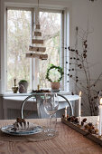 Set dining table with Christmas decorations made from natural materials