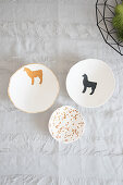 Handmade decorative bowls with lama motifs