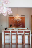 Island counter and bar stools in elegant kitchen