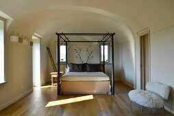 Double bed with designer frame in simple bedroom