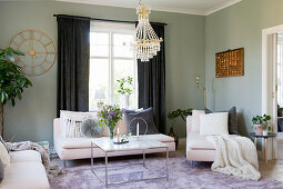 Cushions on chaise and marble coffee table on lilac rug in living room