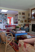 Cosy living room in country-house style with blue coffee table