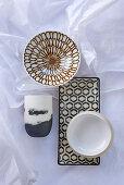 Ceramic bowls, dish and beaker with various patterns