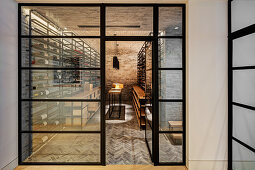 Entrance to wine cellar with wine racks