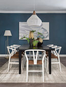 Table and chairs in dining area with blue wall